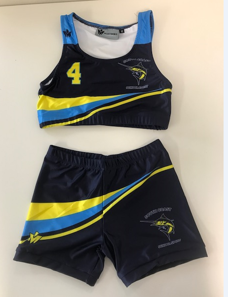 crop top and bike shorts, base colour navy with aqua and yellow wave, and number four on front and back of top
