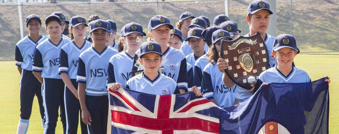 NSWPSSA softball players with flag