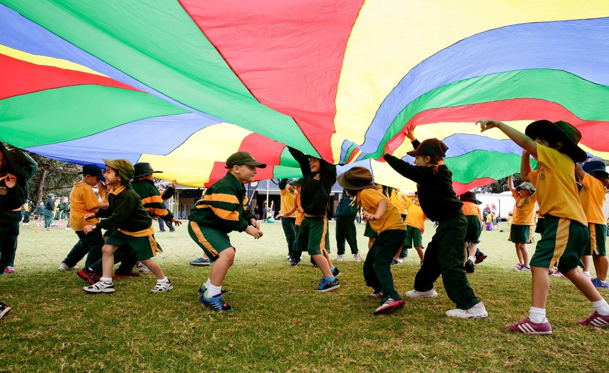 Students playing parachute games