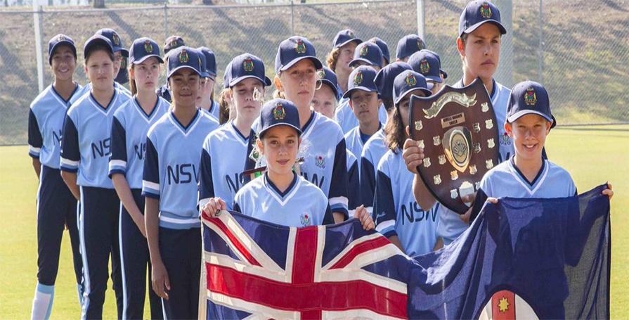 NSWPSSA softball team holding flag and shield